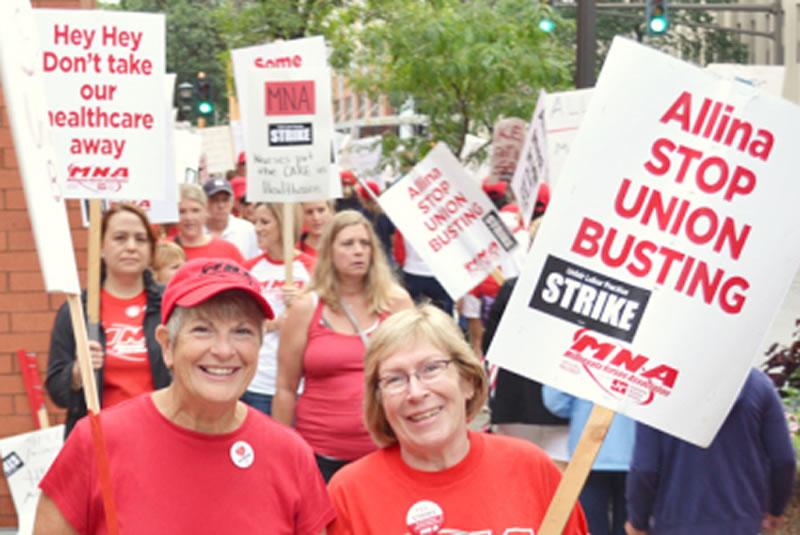 Nurses picket outside United Hospital in St. Paul during an open-ended strike that began on Labor Day. Union Advocate photo