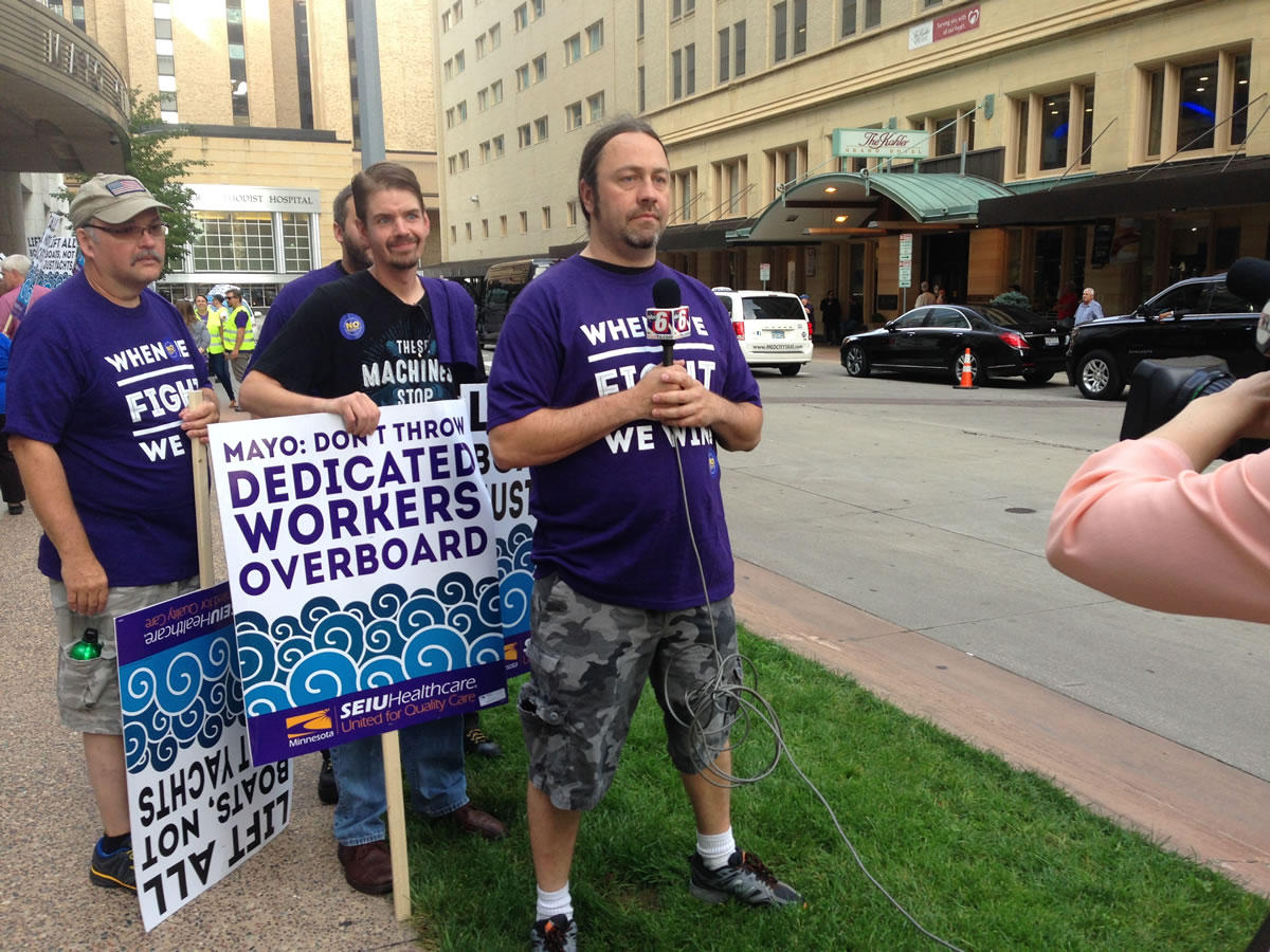 Wes Keck (right) and other food service workers spoke to reporters in September about their plans to seek union representation. Workday Minnesota photo