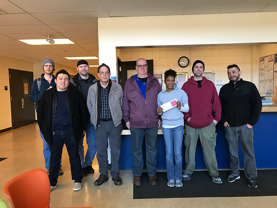 Franklin Street Bakery workers and representatives of the Bakery, Confectionery, Tobacco & Grain Millers Union and the Minnesota AFL-CIO presented a check for more than $1,000 to support the food shelf at Waite House in south Minneapolis.