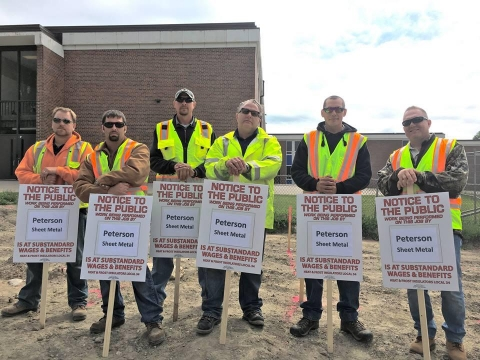 Heat and Frost Insulators Local 34 says Peterson Sheet Metal is not complying with area standards on two school projects in Waconia. Minneapolis Labor Review photo