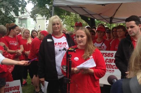 Flanked by MNA President Mary Turner, Registered Nurse Angela Becchetti addressed reporters Monday. Workday Minnesota photo