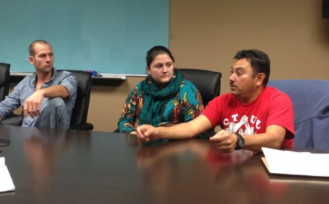 Elmer Santacruz of CTUL calls on U.S. Senator Amy Klobuchar to speak out forcefully for fair trade as Nolan Lenzen of the Landstewardship Project and Ruth Schultz, also of CTUL, look on. Workday Minnesota photo