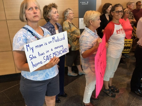 Citizens took part in a news conference at the state Capitol to share concerns about threats to health care. Photo courtesy of ISAIAH via Twitter