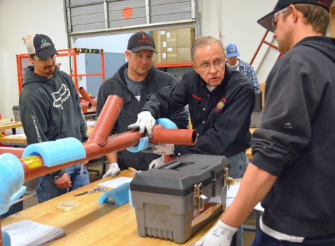 Heat and Frost Insulators Local 34 instructor Lee Houske drives home a point to apprentices about pipe insulation.