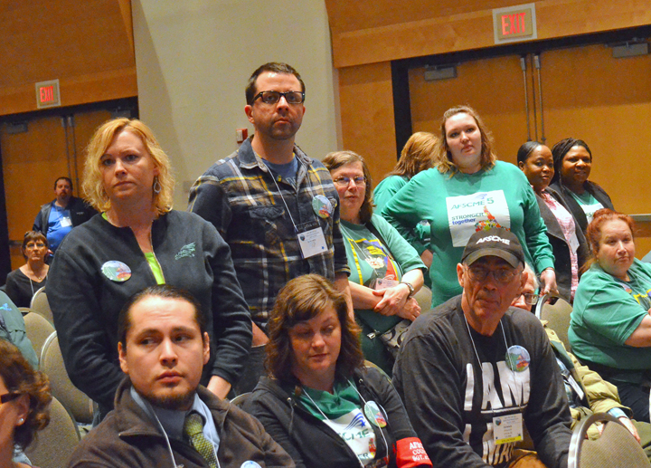 Workers who have been injured or assaulted on the job at a state mental health facility stand up during AFSCME Council 5's Day on the Hill rally. Photo via St. Paul Union Advocate.